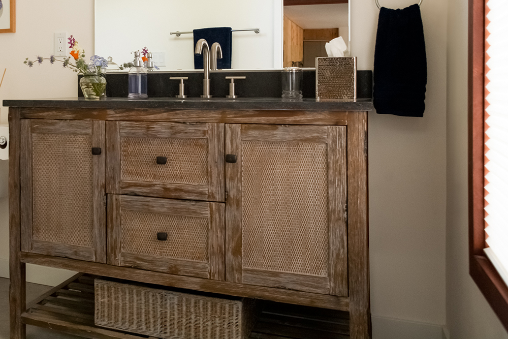Rustic design master bathroom at the River's Edge Cottage vacation home rental