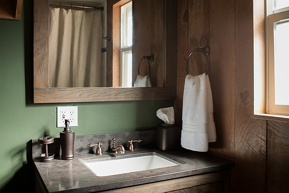 Natural wood, forest elements and rustic bathroom interior design for the River Willow Cabin