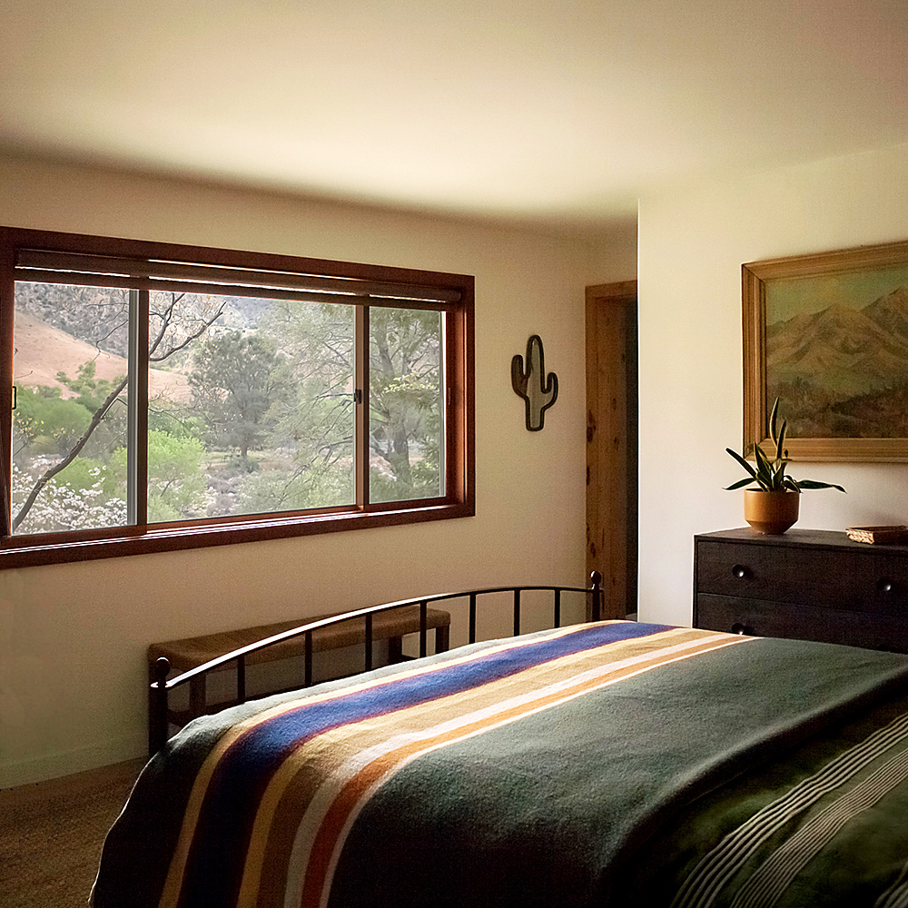 Sierra sunlight from the Sequoia National Forest in the master bedroom of the River's Edge Cottage in Kernville, CA