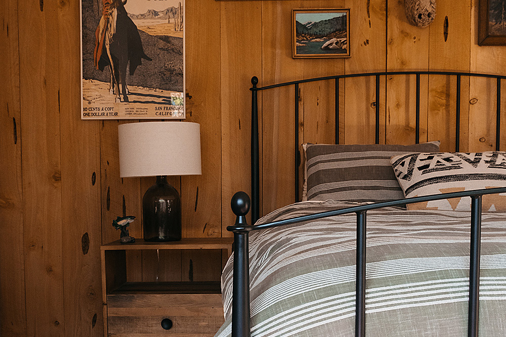 Remodeled rustic cabin cottage bedroom at the Kern River House. Curated boho interior design.
