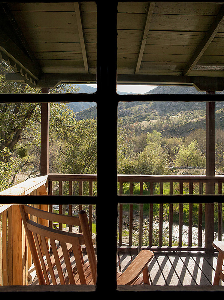 Relaxing deck with rocking chairs, beneath the Sierra Nevada mountains